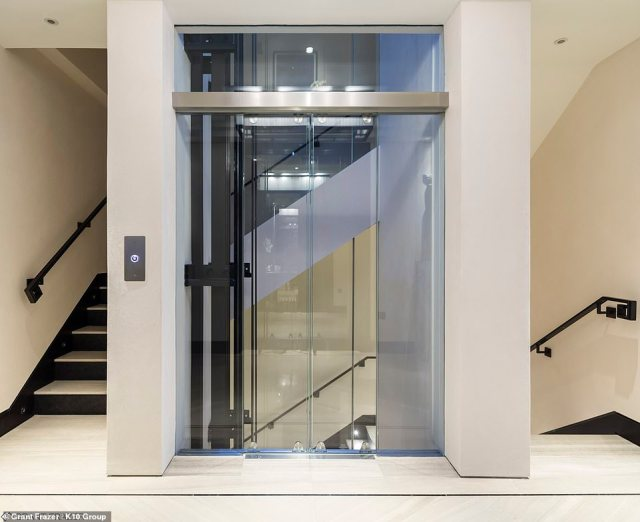 The town house also features a glass lift for guests and its corridors are paved with marble. Pictured: the stairwell of the home built on the site of Coach House of the Earls of Essex