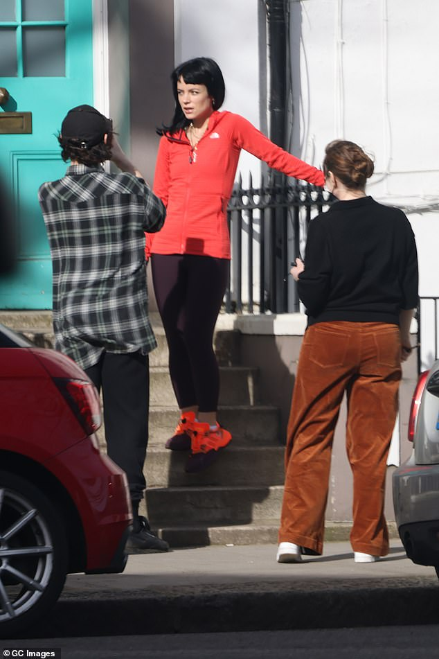 Wow!  Radiant Lily Allen showed off her slender figure in sportswear during an outdoor photoshoot in Notting Hill on Tuesday