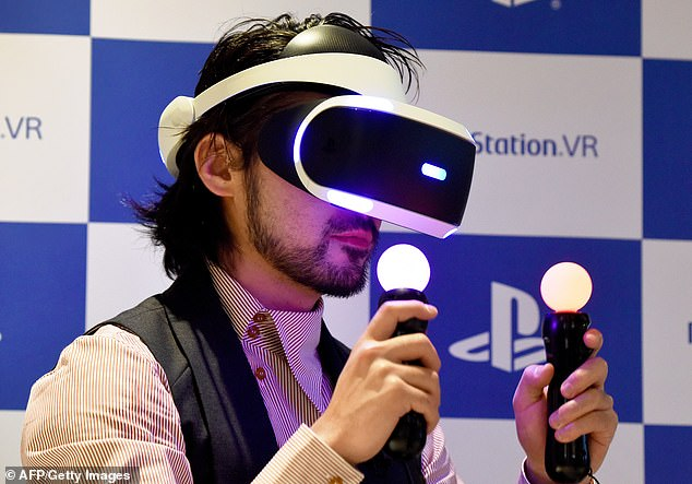 Sony confirmed Tuesday that the PlayStation 5 (PS5) will be getting a new VR headset that is said to provide the 'ultimate entertainment experience.' Pictured is the current VR headset and controllers first released in 2016