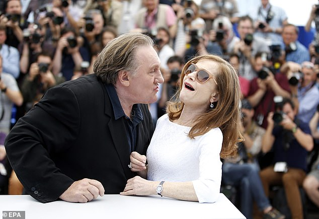 Depardieu  with French actress Isabelle Huppert as they pose during the photocall for 'Valley of Love' at the 68th annual Cannes Film Festival, in Cannes, France in 2015