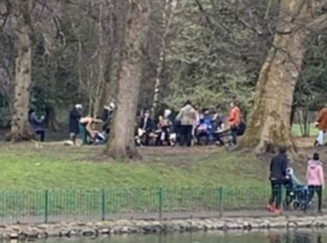 Musicians in Manchester play their drums in a circle in a park - in breach of rules on gatherings