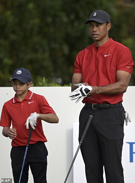 Woods with his 12-year-old son Charlie in December