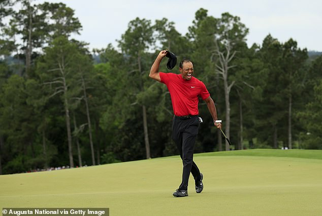 Woods celebrates winning the Masters at the Augusta National Golf Club on Sunday, April 14, 2019