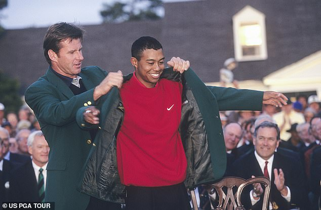 Tiger Woods and Nick Faldo of England during the final round of the 1997 Masters Tournament at the Augusta National Golf Club on April 13, 1997 in Augusta, Georgia