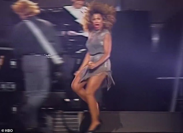 Those legs: Her iconic hit Proud Mary is also heard, as she concludes the voiceover with, 'And I'm here for you!'