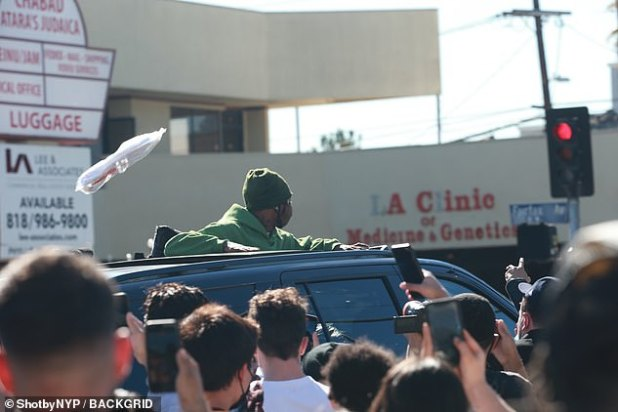 Appearing: Scott could still interact with everyone through the sunroof of his car.