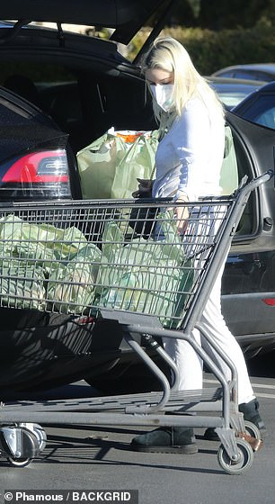 She left the store with a cart full of purchases