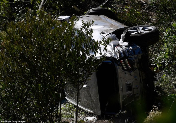 The vehicle driven by golfer Tiger Woods lies on its side in Rancho Palos Verdes, California, on Tuesday, after the accident
