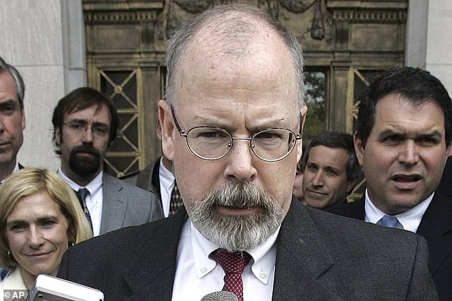 U.S. Attorney John Durham, center, said the Justice Department has 'reconsidered the matter'