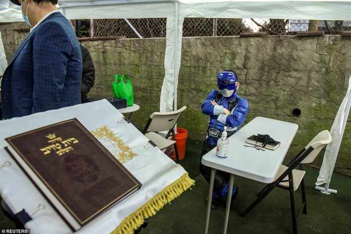 Eliyahu Jacoby, 6, dresses as a Power Ranger as he prepared to listen to a special service to celebrate the holiday