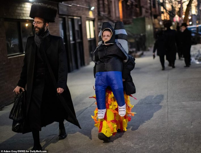 One youngsters looked to be dressed up like a rocket man with a creatively arranged costume as he walked the streets