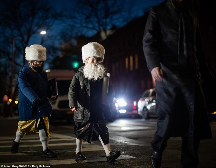 One little girl seemed to enjoy dressing up together with a beard as she followed in her father's footsteps