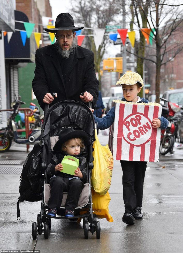 This little boy strutted down the streets in his genius homemade popcorn costume, complete with a popcorn covered cap,Pictured in 2019