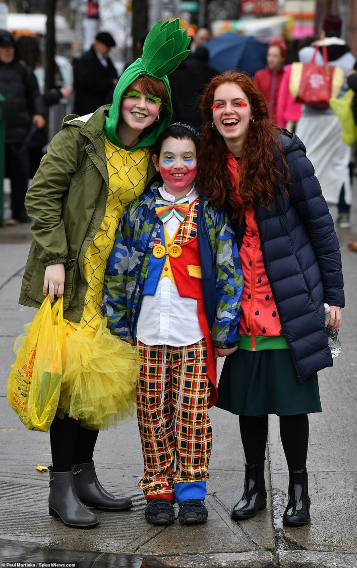 This vibrant trio was spotted in Brooklyn on Thursday dressed as a pineapple, strawberry and a cheerful clown ,pictured in 2019