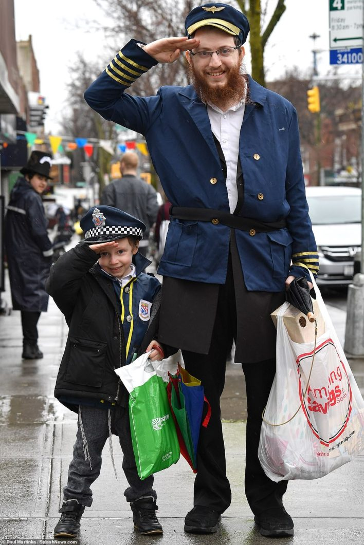 Mini me! A proud father dressed as an officer and his son dressed as a cop saluted cameras as they walked through Brooklyn,pictured in 2019