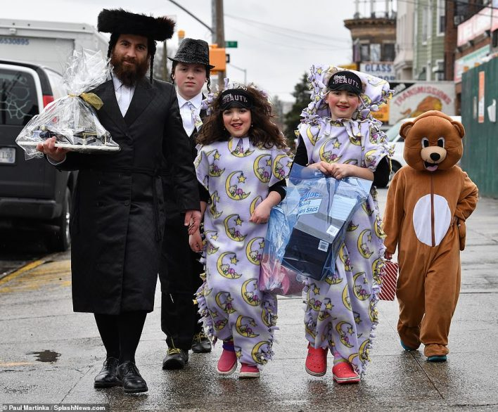 Families were seen walking to synagogue with presents and in fun costumes for the special holiday,pictured in 2019