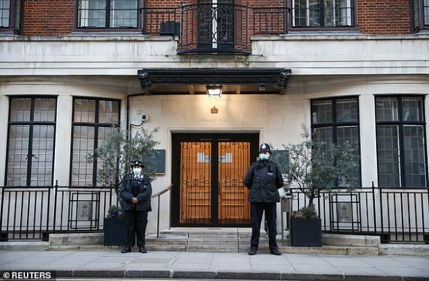 The police officers are outside the King Edward VII Hospital, where Prince Philip is being treated.