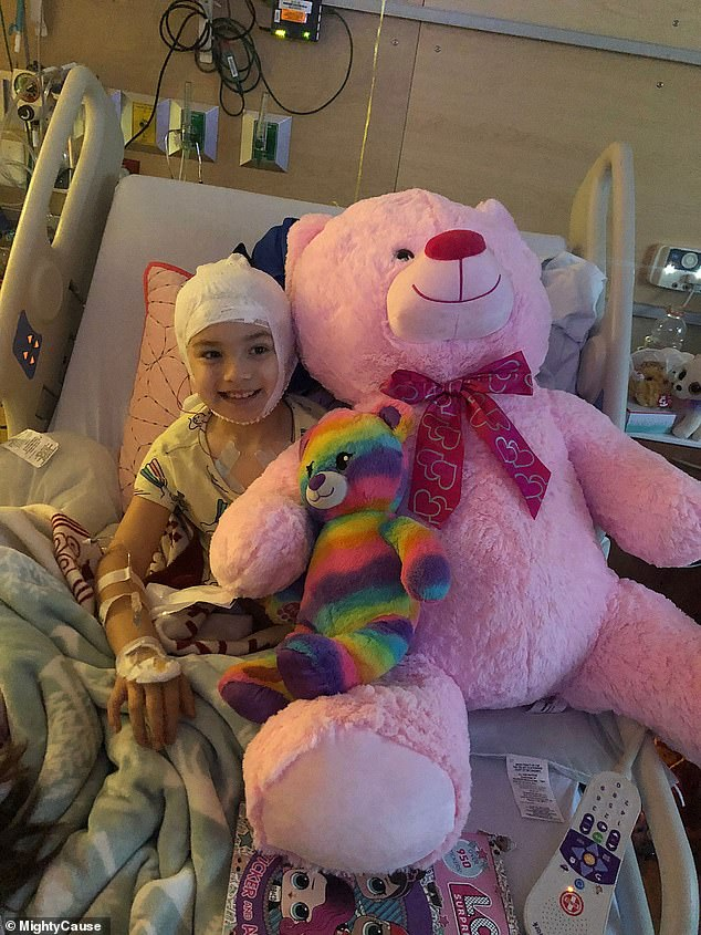The little girl was diagnosed this month with three rare cerebral malformations - an irregularity of the brain - after she suffered a seizure back in January. Pictured in hospital this month