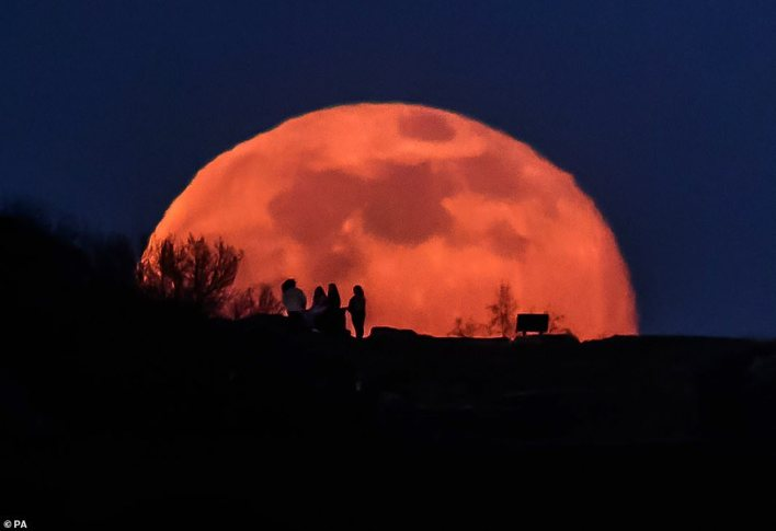 February's full moon (pictured in Wakefield) is also known as the 'Hunger moon' due to the brutal weather conditions that made it harder for tribes to go out and hunt for food