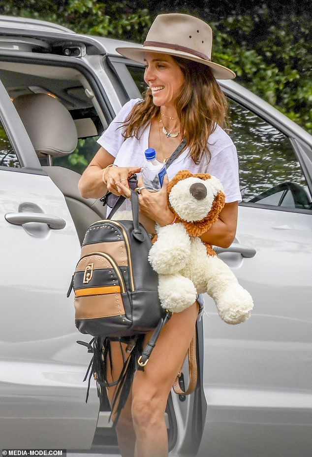 Playing: Chris, 37, had the two dogs in tow, while Elsa, 44, held a plush dog toy, presumably for their children, daughter India Rose, eight, and twins Sasha and Tristan , six years.