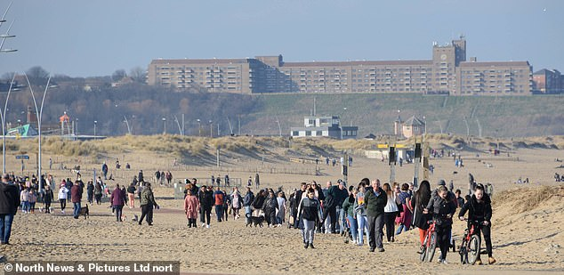 Sunseekers flock to the seaside ignoring Government appeals to stay indoors to stop the spread of Covid