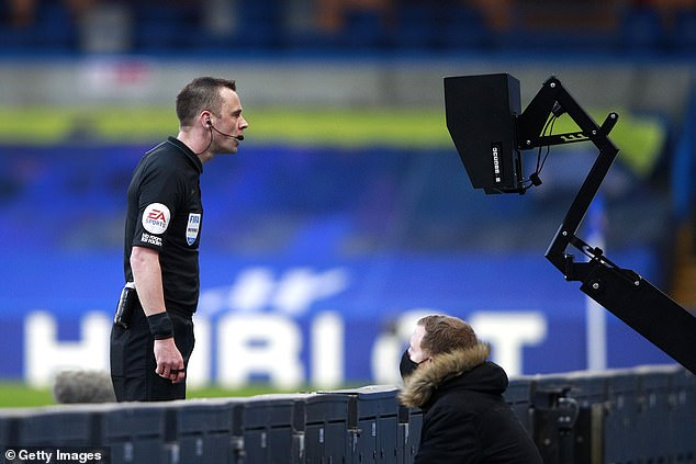 Stuart Attwell didn't award Manchester United a penalty after Chelsea's Callum Hudson-Odoi handballed in the box - despite consulting the pitchside VAR monitor