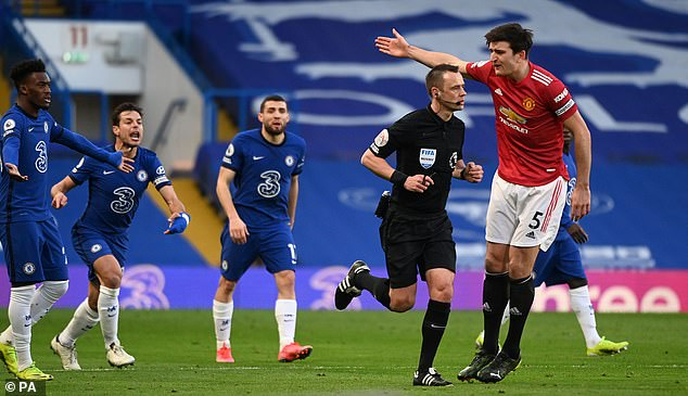 Harry Maguire appeals for a penalty to referee Stuart Attwell following a VAR check on Sunday