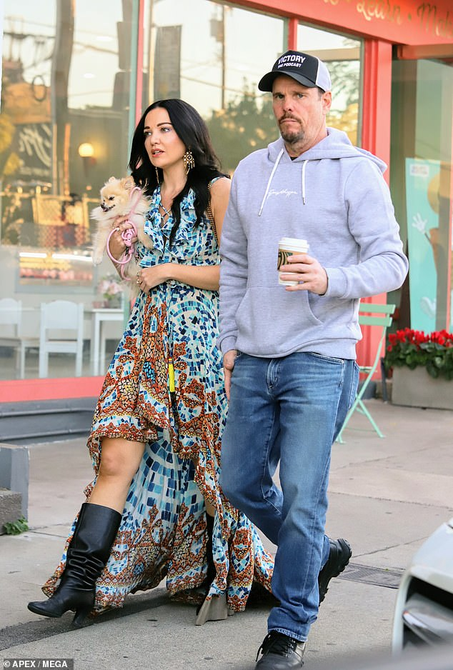 The actor donned an ash gray hoodie with blue jeans and black shoes as he held a coffee in his hand