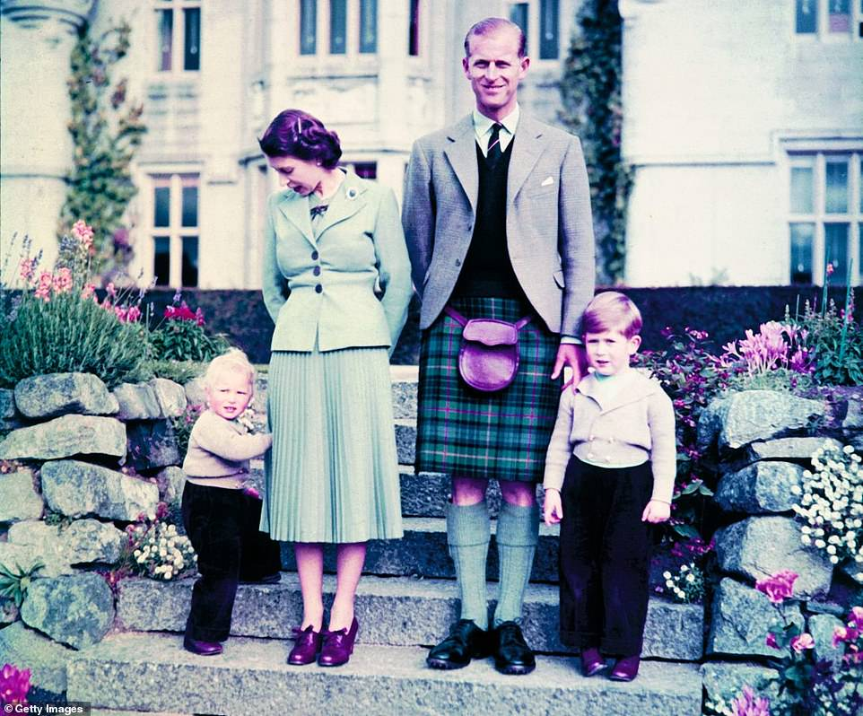 The then Princess Elizabeth and the Duke with their two young children, Princess Anne and Prince Charles, outside Balmoral Castle in Aberdeenshire on September 19, 1952
