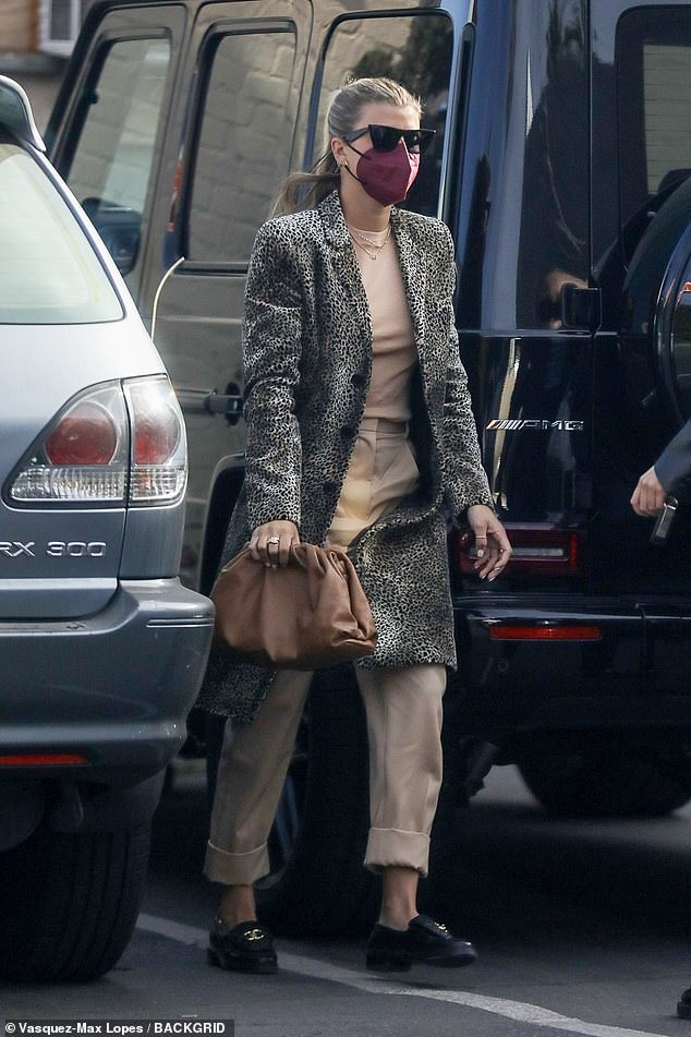 Stylish: The 22-year-old daughter of Lionel Richie turned heads in a stylish cheetah print coat that she layered over a nude toned tee