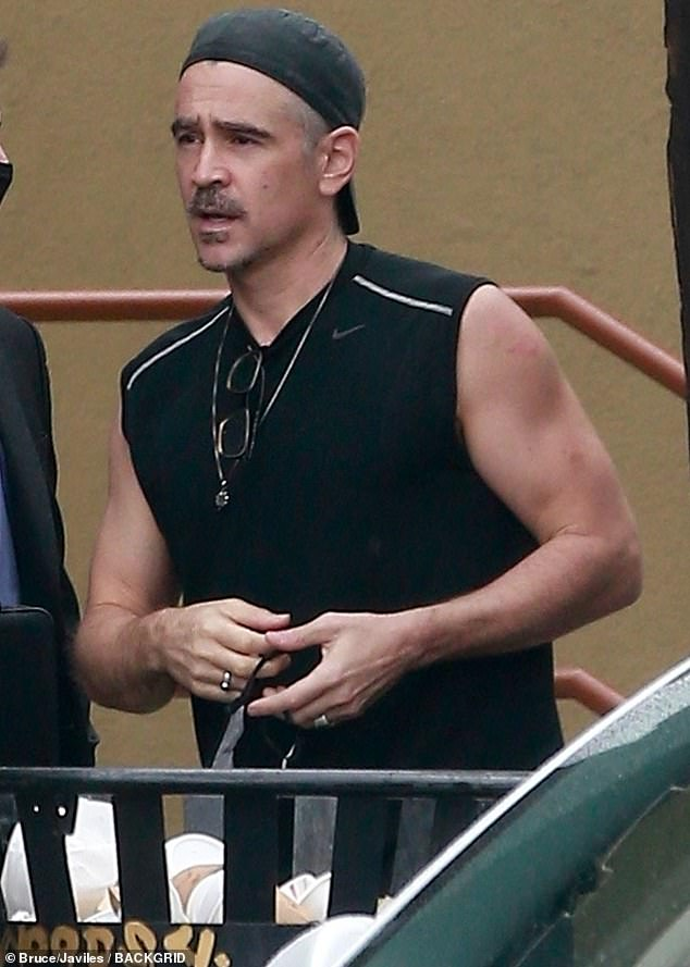 Dashing: Colin Farrell showed off his toned arms in a sleeveless top as he surfaced from lockdwon in Los Angeles on Wednesday