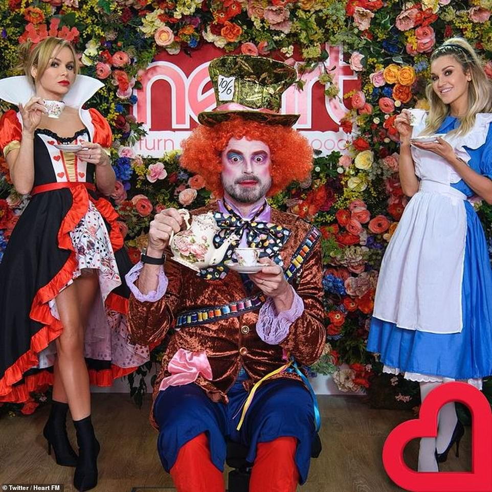 Different looks: Amanda Holden also dressed up on her Heart Breakfast show, with the presenter, 50, emulating Queen of Hearts from Alice in Wonderland, while Ashley Roberts and Jamie Theakston became Alice and the Hatter crazy.