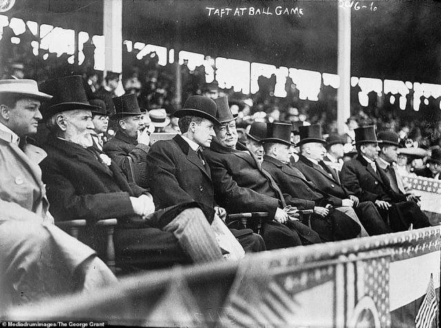President William H Taft (pictured middle) is seen in Washington in 1910 attending a baseball game. Taftwas the first president to throw out the first ball at a Major League Baseball season opener.Taft is the only man to serve as both president of the United States and Chief Justice of the Supreme Court and is also one of two Presidents to be buried in Arlington National Cemetery. He is also well known as the heaviest President, weighing in at over 300 pounds. He served as President between March 4, 1909 and March 4, 1913