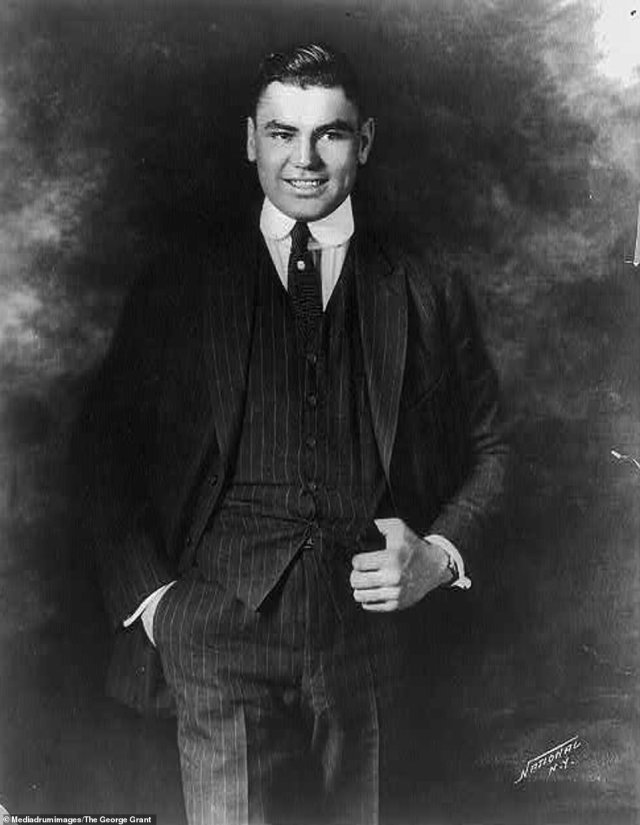 Professional boxer Jack Dempsey is seen posing in a suit in 1895. Dempsey, nicknamed Kid Blackie, and The Manassa Mauler, was an American professional boxer who competed from 1914 to 1927, and reigned as the world heavyweight champion from 1919 to 1926. His exploits in the ring helped set financial and attendance records for boxing, including the world's first million-dollar gate. Dempsey was also responsible for pioneering the live broadcasts of boxing and sports more generally