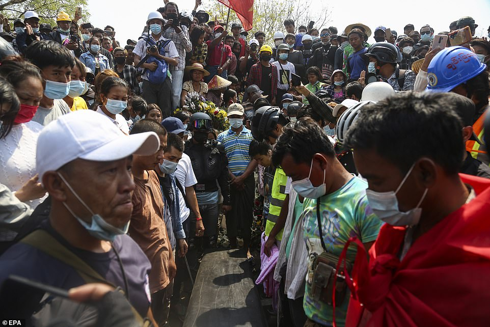 People gather around the coffin of Ma Kyal Sin during her funeral in Mandalay, a day after the 19-year-old was shot dead by police