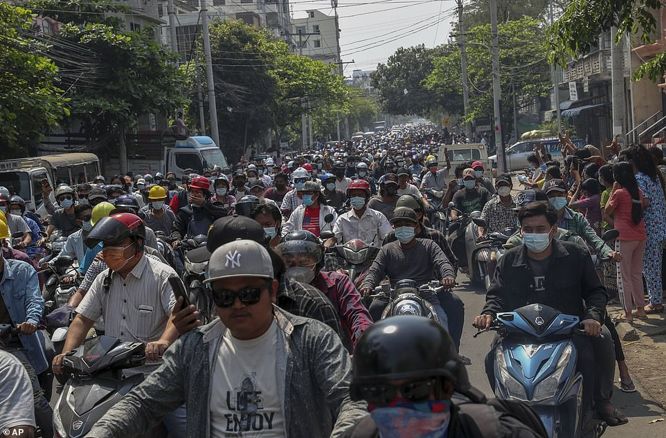 Hundreds of people accompany a hearse carrying the body of Kyal Sin, who was shot in the head by security forces, for burial in Mandalay on Thursday