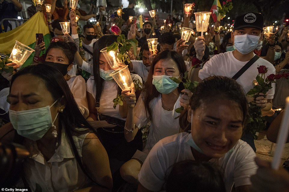 Grieving Myanmar nationals hold a candlelight vigil outside the UN Headquarters in Bangkok on Thursday
