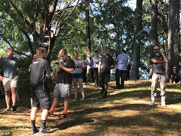Whangarei residents wait patiently on high ground after receiving an emergency alert warning about an incoming tsunami