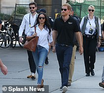 THE AMERICAN SPIN DOCTOR: Jason Knauf (left) walks behind the couple at the Invictus Games in Toronto