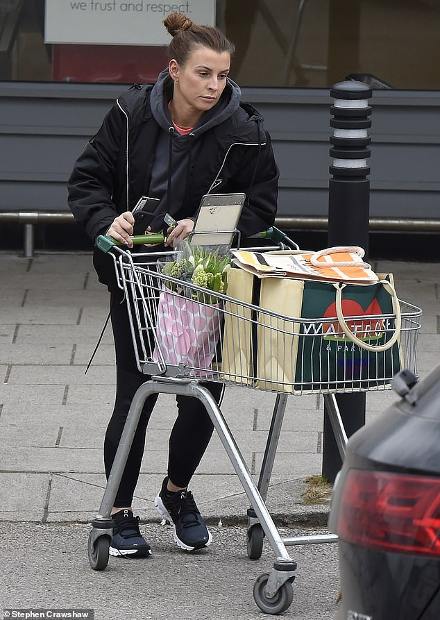 Getting out: Coleen Rooney was seen taking her new £ 97,000 car for a drive through her village in Cheshire while shopping for weekly groceries on Friday morning