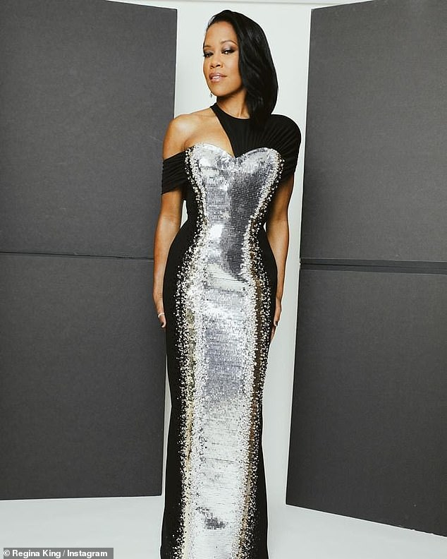 Stunning: On Sunday, she landed on nearly every best-dressed list at the virtual Golden Globes ceremony sporting a black and silver column dress from the luxury brand embroidered with 40,000 sequins