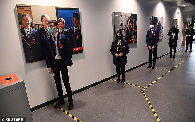 Year 10 students wait take a coronavirus test at Harris Academy Beckenham, ahead of full school reopening in England , in Beckenham, south east London, Friday