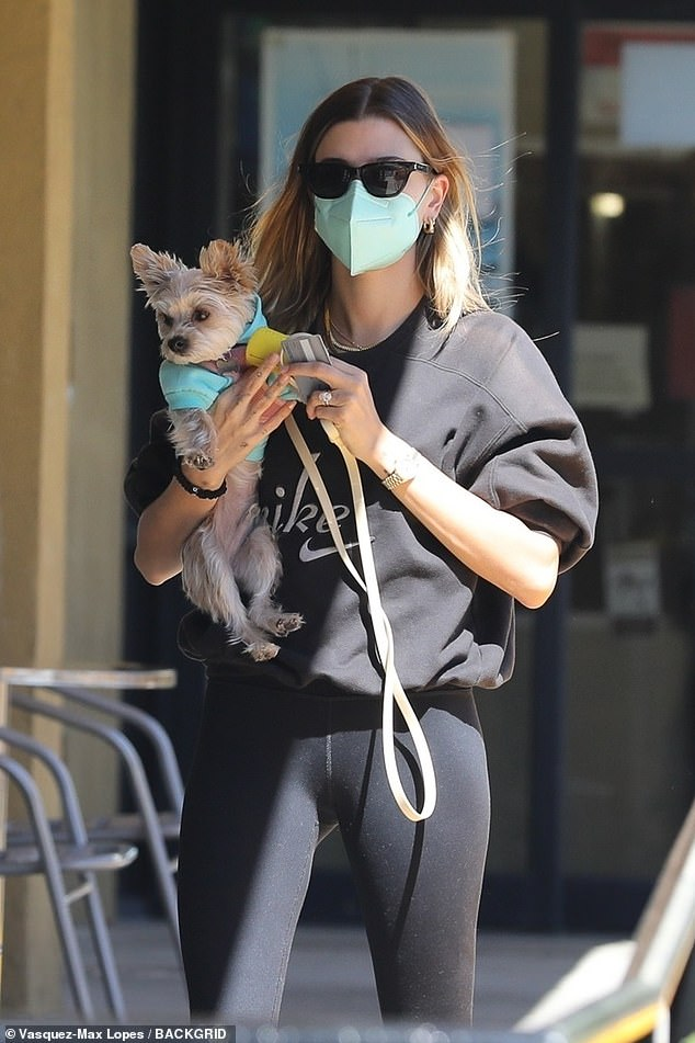 Companion: Hailey has arrived with her cute puppy.  Model Hilfiger wore a black sweater and leggings