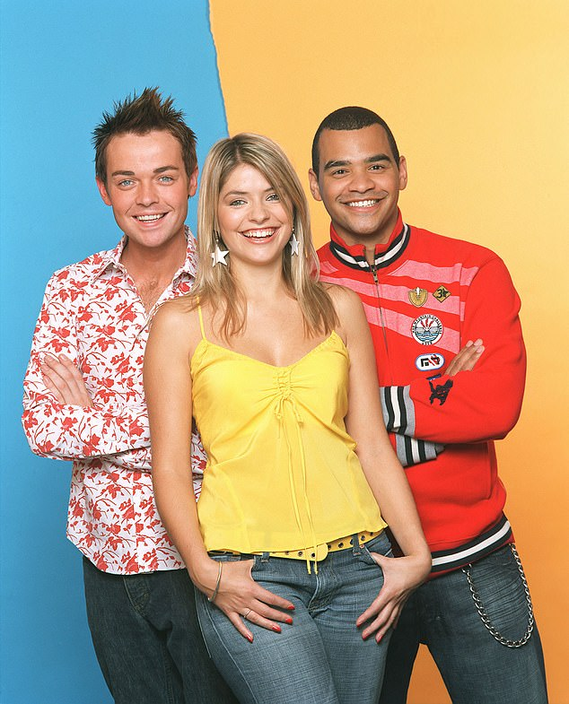TV stars: Michael pictured here with a young Holly Willoughby and Stephen Mulhern in 2004