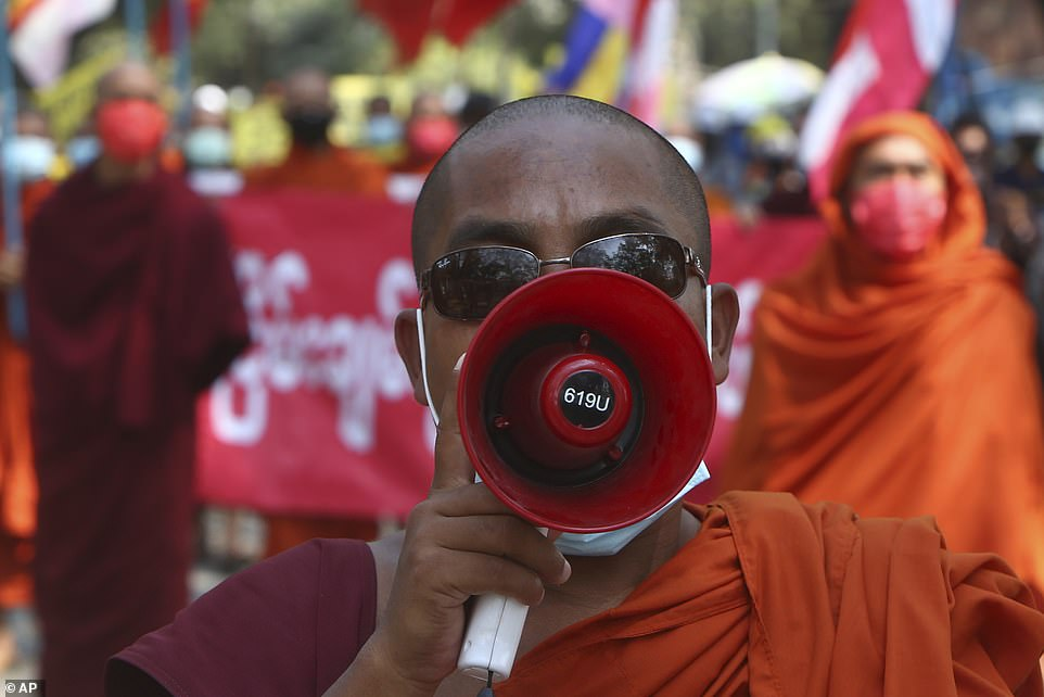 Pictured: Monks shout slogans during a protest against the February 1 military coup in Mandalay, Myanmar, seen on Saturday, March 6