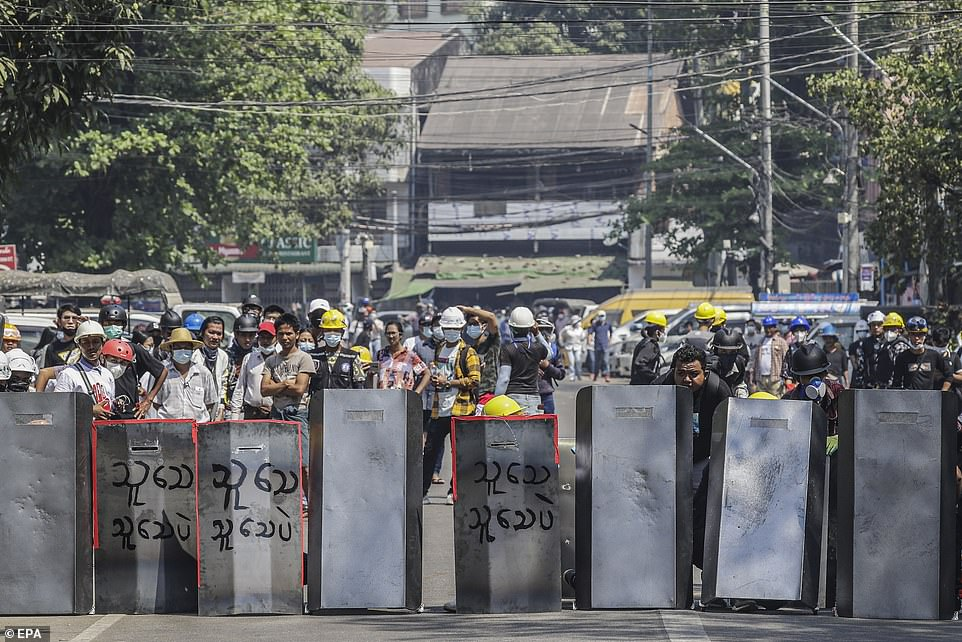 Anti-coup demonstrators returned to the streets of Myanmar Saturday, a day after a United Nations envoy urged the Security Council to hear the nation's 'desperate pleas' and take swift action to restore democracy. Pictured: A wall of demonstrators on March 6, 2021 in Yangon