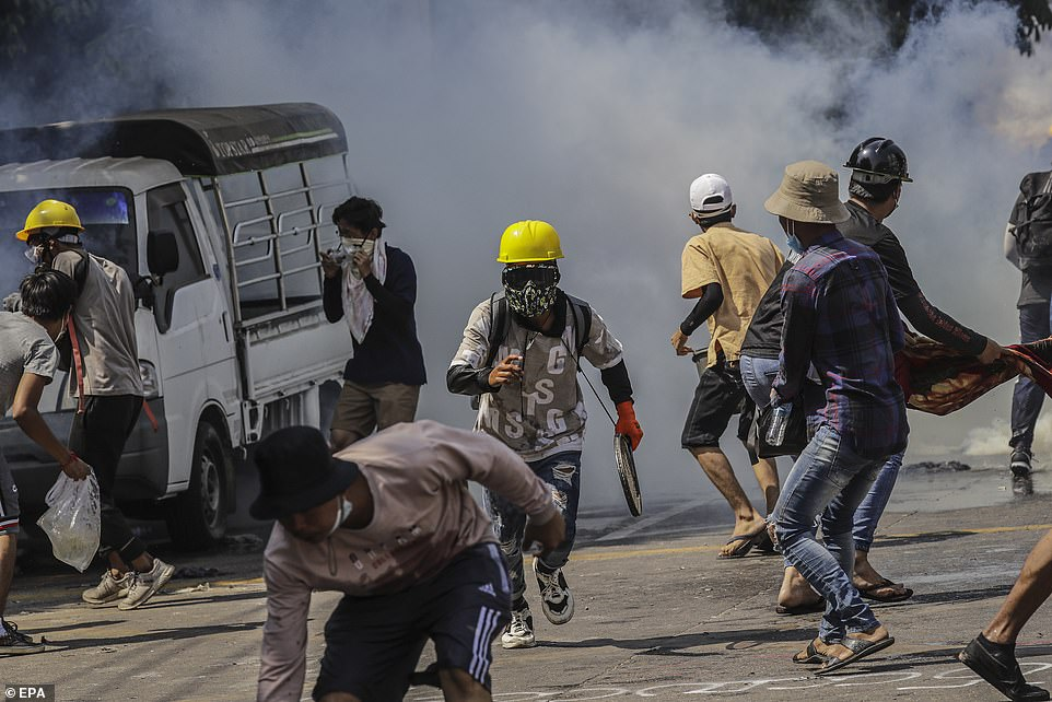 Security forces have escalated an increasingly brutal crackdown on demonstrators - killing more than 50 people since the coup - but protesters rallied again on Saturday (pictured)