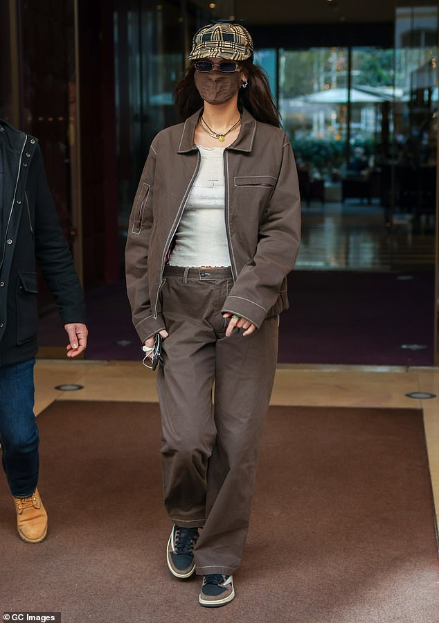 Fashion: Bella Hadid was sure to catch the eye in an edgy brown jacket and trousers set while stepping out in Paris on Saturday