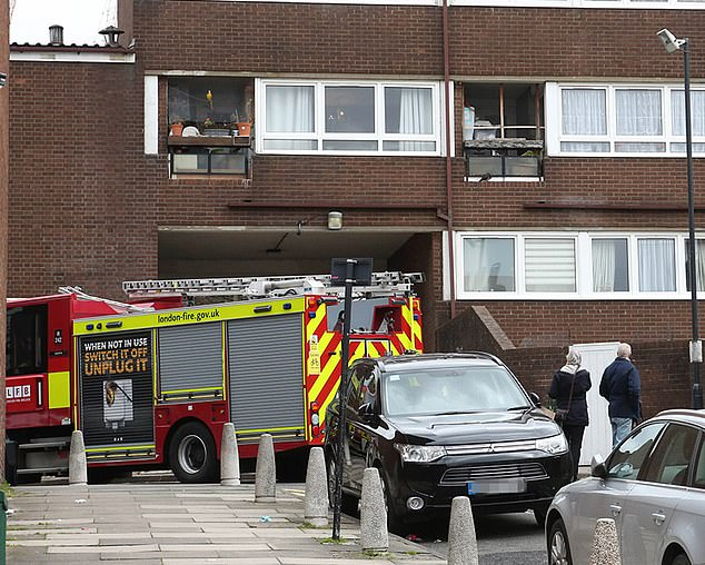 Firefighters rescued a woman and two children from the top floor of the building, London Fire Brigade said