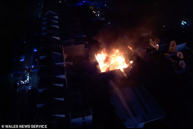 Aerial footage capturing the aftermath of the exposion. Prosecutor Helen Randall said nearby homes were evacuated in Swansea, South Wales, as the fire took hold